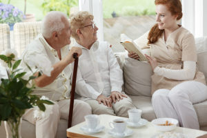 older couple talking with a caregiver