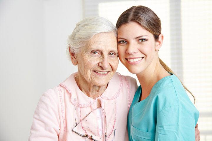 Caregiver with senior woman
