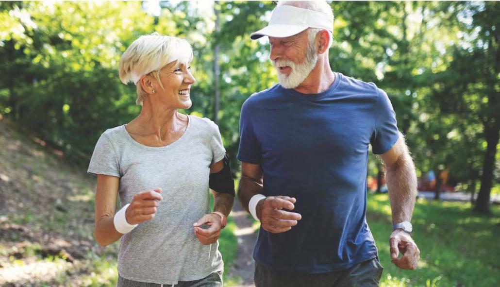 Senior couple running outside their home
