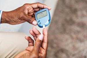 diabetic measuring blood sugar