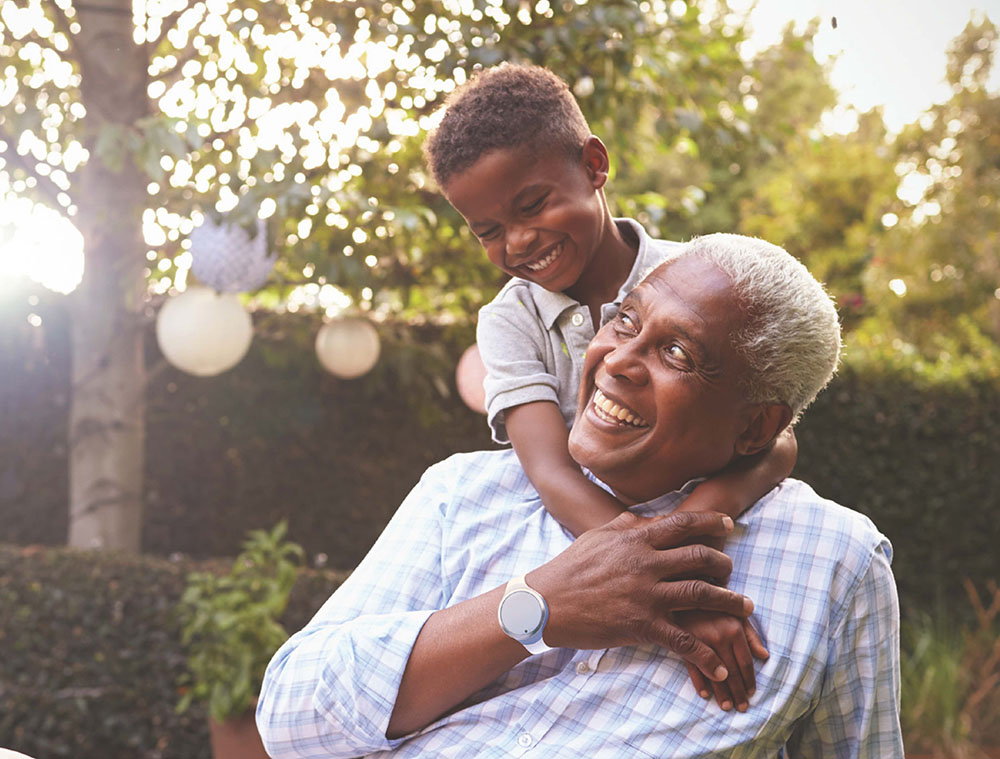 Senior Home Care Patient playing outside with his grandson
