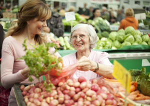 The elderly woman at the market place with daughter