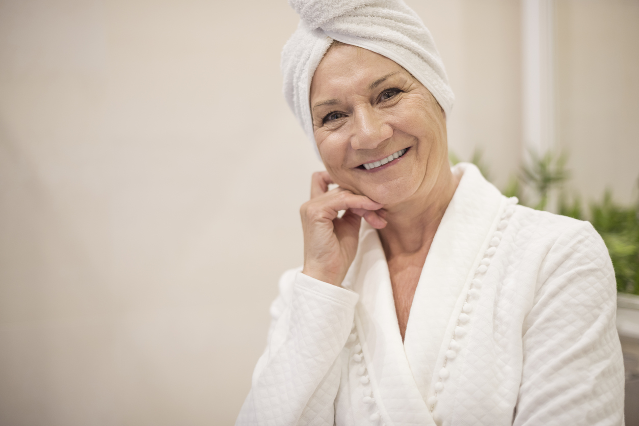 Senior woman with towel on her hair
