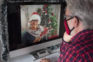 senior man on Christmas video call