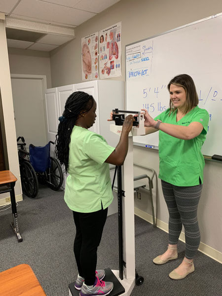 Students taking weight measurements